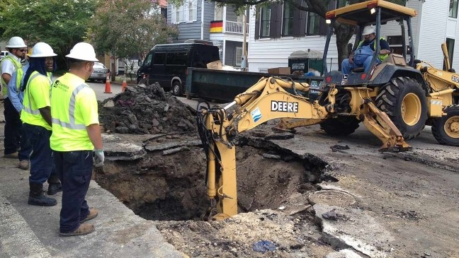 Road collapses under weight of fire truck in downtown